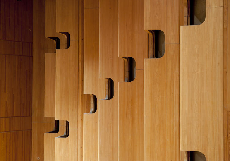 Photo of wooden paneling inside the Barbican Concert Hall
