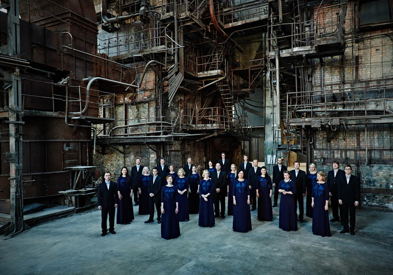 Photo of Estonian Chamber Choir against an industrial background