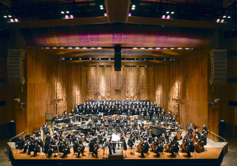 A photo of the Barbican Concert Hall with orchestra playing