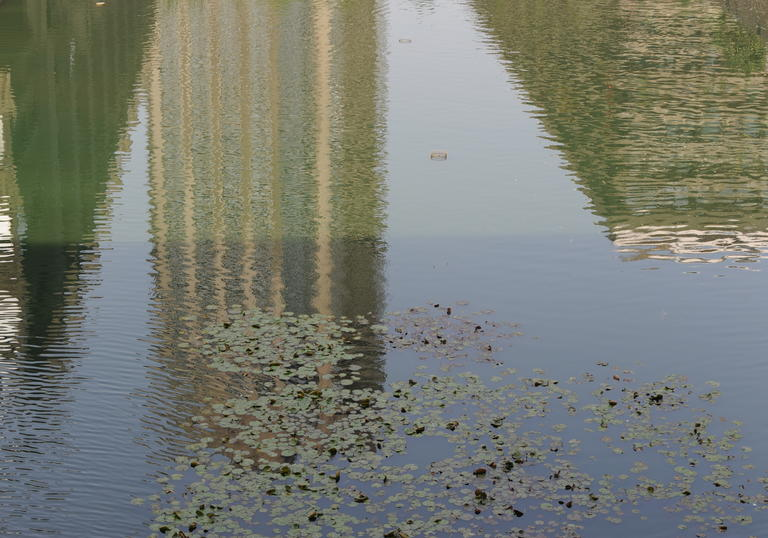 An image of the Barbcian towers reflected in Lakeside