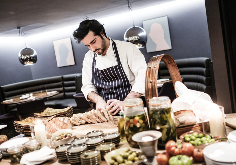 A photo of a chef in Barbican's restaurant, Osteria