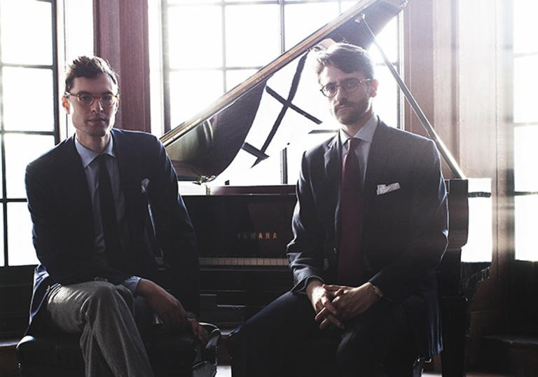 A colour photograph of Timo Andres and David Kaplan by a piano