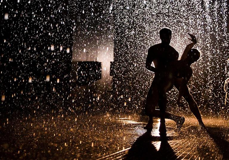 Photo of two people dancing in the Rain Room