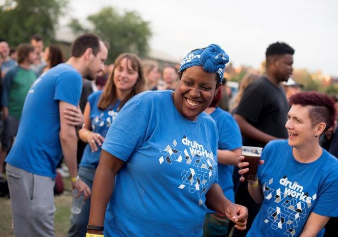 Photo of people from Drum Works laughing at Walthamstow Garden Party