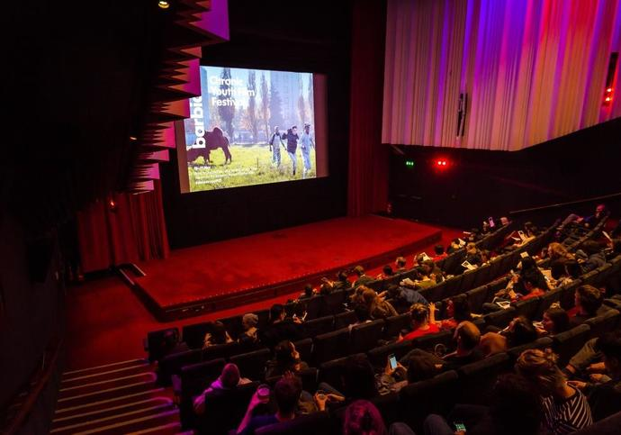 Photo of audience watching a film in the Barbican Cinema