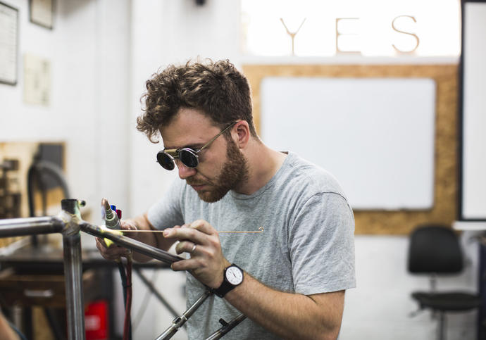Image of Andrew Denham of The Bicycle Academy making a bike