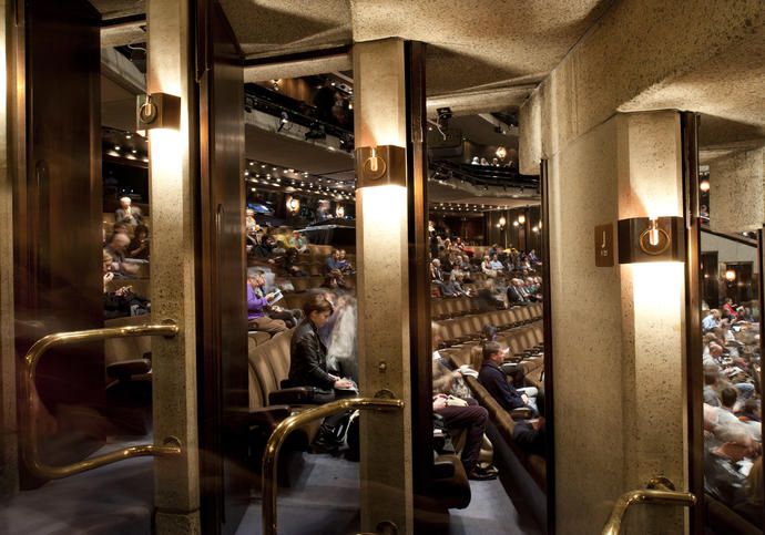 Photo through the doors of the Barbican theatre into the stalls