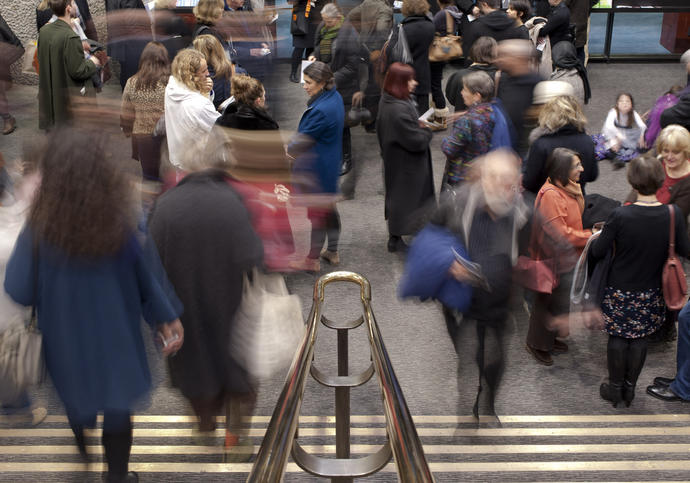 Photo of crowd of people on stairs in Barbican Foyers