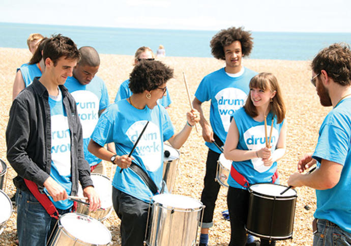 Photo of group of musicians from Drum Works playing drums