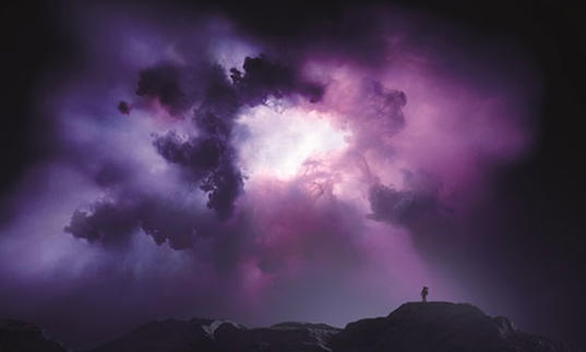 Photo of purple space landscape with a human figure in the distance