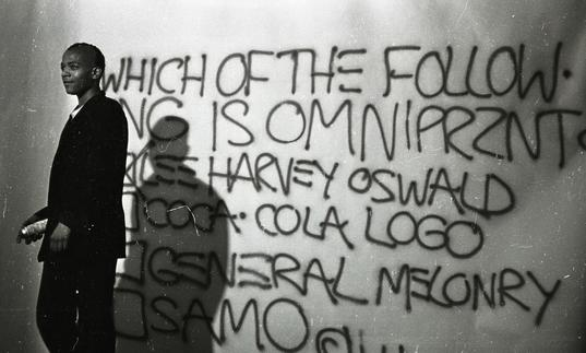 Photo of Basquiat with graffiti