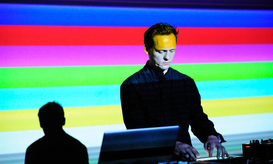 Carsten Nicolai AKA Alva Noto plays top class Electronic music in front of a digital rainbow