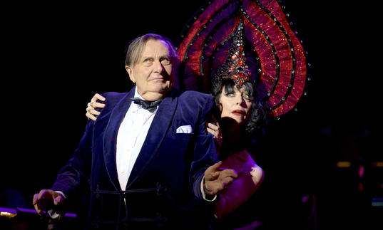 photo of barry humphries on stage with a female dancer