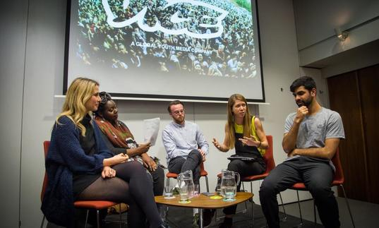 Photo of group of young people in a panel discussion