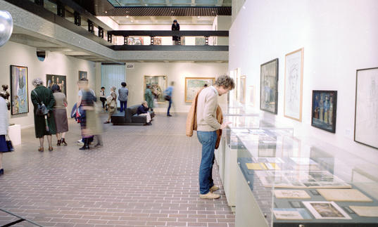 Archive photo of man looking at art in the Barbican Art Gallery