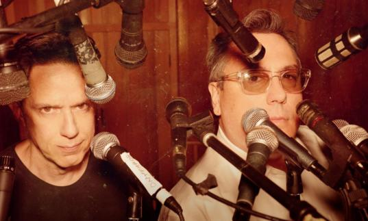 They Might Be Giants standing in a sea of microphones