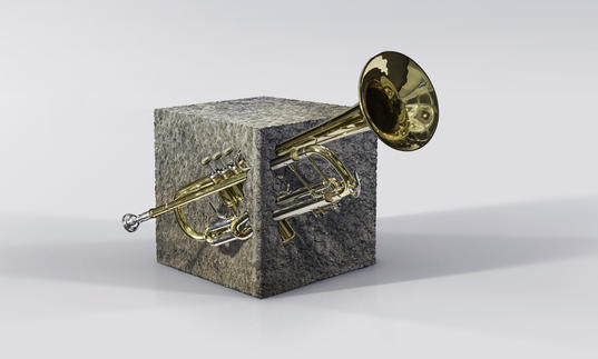 A trumpet embedded in Barbican concrete