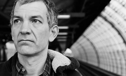 Brad Mehldau waiting for a train in black and white