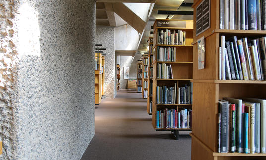 Photo of Barbican Library shelves
