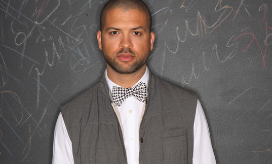 Jason Moran in a white shirt and grey waistcoat