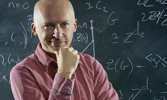 Marcus du Sautoy in front of a blackboard