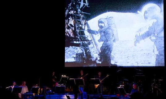 Icebreaker performing in front of footage from the Apollo moon landing