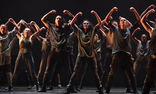 Dancers with arms in air