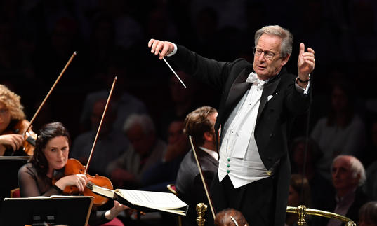 John Edward Gardiner conducting masterfully on stage