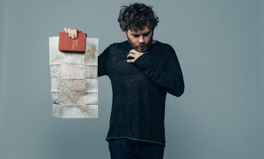 Gabriel Kahane holds up a map of North America