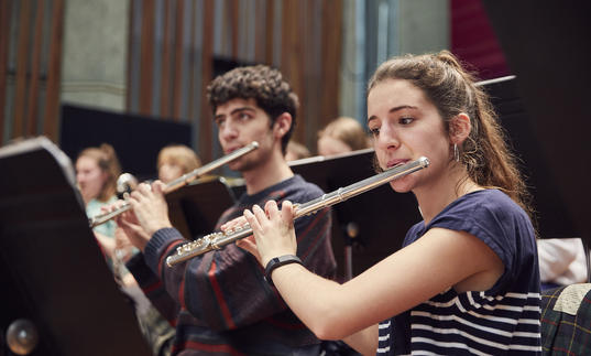 Two flautists in Guildhall Symphony Orchestra