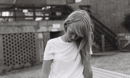 Lucy Rose pictured in black and white looking down