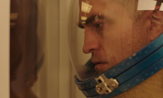 A close up of Robert Pattinson in astronaut gear