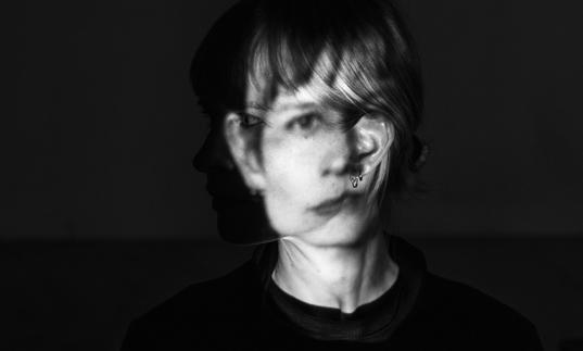 A black and white photo of Jenny Hval with her face distorted
