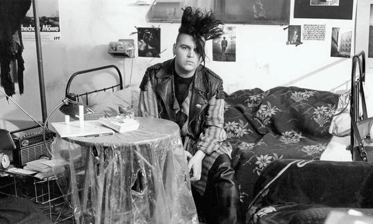punk man sitting at a table