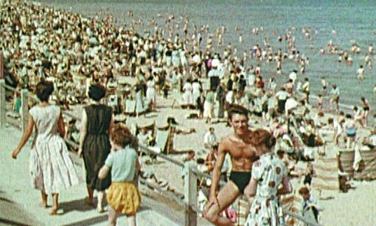 An image of holiday makers on a beach in Scotland