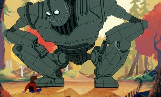the iron giant crouching over a young boy
