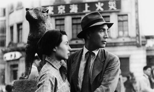 A black and white image of a man and a woman in Japan in the 1940s