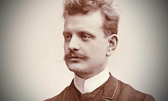 A old fashioned sepia portrait image of Jean Sibelius