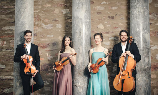 The Aris Quartet posing with their instruments