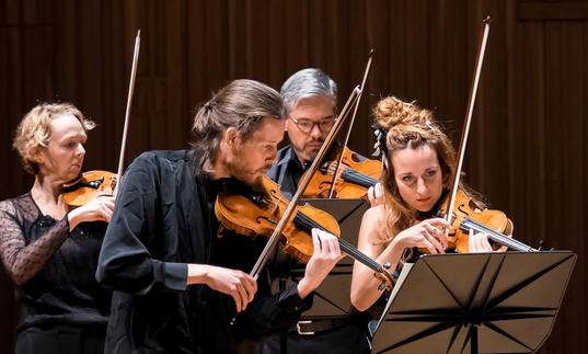 An image of the Britten Sinfonia musicians playing their instruments