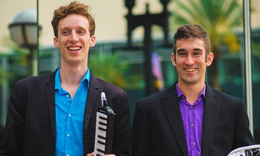 The Melodica Men smiling excitedly