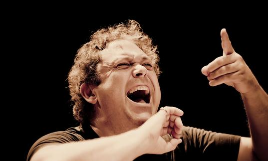 An impassioned Richard Edgarr conducting with an open mouth