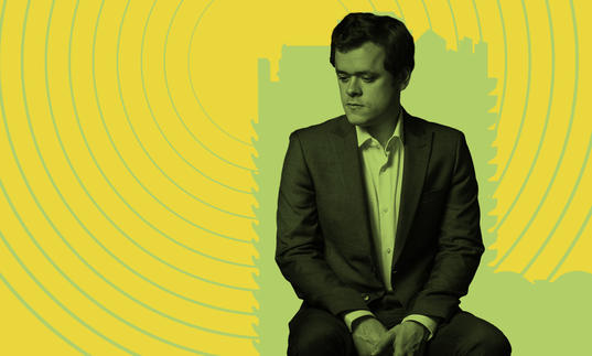 Benjamin Grosvenor looking pensive against an illustrated backdrop of the Barbican