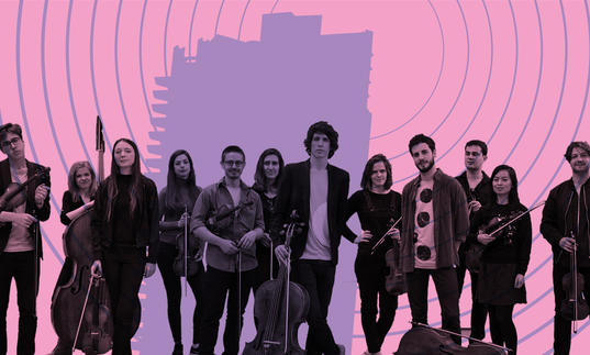 12 Ensemble with their string instruments, standing in front of the Barbican tower with radio broadcast waves emitting