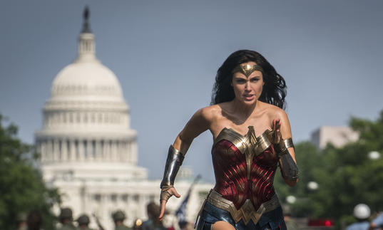 Wonder Woman runs with the backdrop of the United States Senate