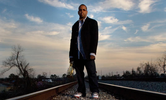 Terence Blanchard standing on train tracks - watch out, Terence!