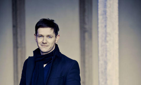 A full colour photograph of Iestyn Davies