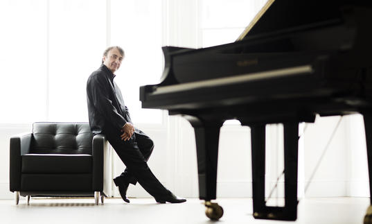A full colour photograph of Jean-Efflam Bavouzet and piano