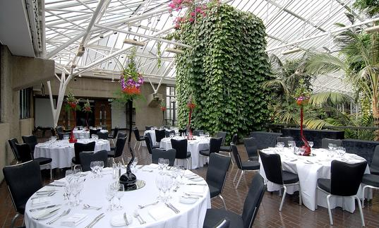 Photo of the Barbican Conservatory Terrace laid out with tables