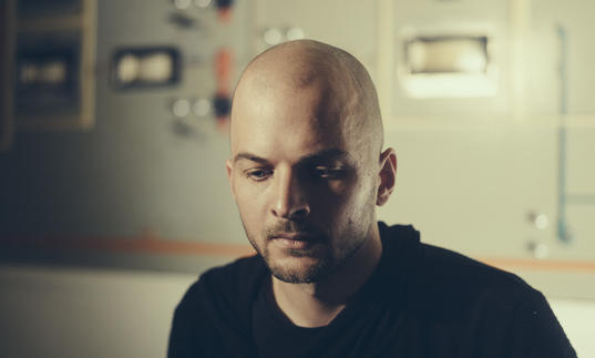 Nils Frahm gazing downwards